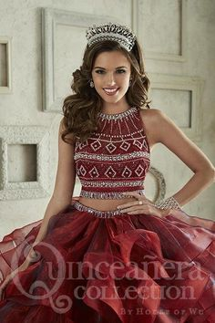949226558b0 A two-piece ball gown crowned by a heavily beaded bodice composed of  symmetrical beadwork