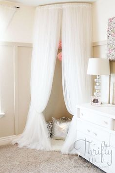 Make a Cute Reading Nook out of Curved Curtain Rod and $4 Ikea Curtains .