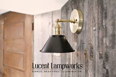 https://www.etsy.com/listing/231927103/wall-sconce-lighting-with-7-flat-black?ref=shop_home_active_1 Wall Sconce Lighting with 7 Flat Black Shade