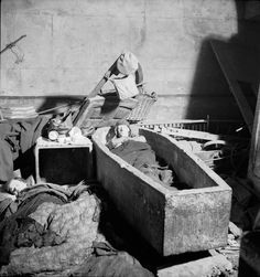 A man sleeps in a stone sarcophagus in an East London church during the Blitz/November 1940 Vintage London, Old London, East London, London Pictures, London Photos, British History, American History, London History, Bill Brandt Photography