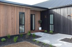 Thinking About Building?Contact us to setup an initial ideas planning meeting Phone 07 839 5570 Send a Message Larch Cladding, House Cladding, Facade House, Building Design, Building A House, Livable Sheds, Flat Roof House, Gable House, New Zealand Houses