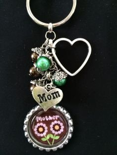 This is a handmade 1 inch bottle cap key chain with a 1 inch epoxy seal, various beads, bead caps, spacers and charms. Handmade Keychains, Diy Keychain, Handmade Jewelry, Artisan Jewelry, Bead Bottle, Bottle Caps, Bottle Cap Crafts, Resin Charms, Diy Purse