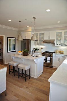 Kitchen #White Cabinets #Silver Pendants