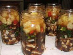 Canning Sweet and Sour Chicken,4-1/2 lbs. chicken, cooked and shredded,2 green bell peppers,diced,2med.onions,chopped,1 red bell pepper, diced.  3-15 oz. c. pineapple chunks, drained, reserve liquid.¾ c. brown sugar.1-1/4 c. white vinegar.6 T. soy sauce.4 T. ketchup.1 t. ginger.In quart jars, layer chicken, onions, peppers, and pineapple chunks.  bring brown sugar, vinegar, soy sauce, ketchup,3 c. pineapple juice to boil.Pour over ing.,Pressure can at 10 pds @ 90 min. 5 qts.