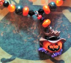 Cute, Happy Scarecrow Face Pendant Dangles from Halloween Glass Bead Necklace!  Orange, Black & Purple Glass Beads, Czech Crystal Beads by SerendipitysRarities on Etsy