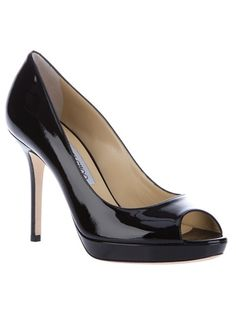 Black patent leather pump from Jimmy Choo featuring a classic style, a 'Perfect Peep-Toe' and a patent leather 3.9