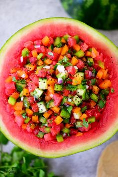 The watermelon salsa recipe is so fun when served from a watermelon bowl at parties! It is delicious with chips or on top of grilled chicken or salmon.