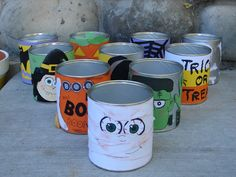 Last year, I somehow found myself in charge of my daughters halloween party at school…hmm..25 kids. yeah. I had to think of something that would entertain. ENTERTAIN. I had all these old formula tins (um..do I need to once again remind you of the hoarding that is me?) and I hot glued decorations onto them. …