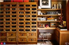 dressing room. Fulk's walk-in closet, a former guest room, features vintage shoe-display cabinets from London.