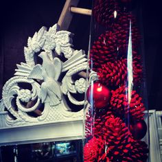 Holiday vase filler, red painted pinecones and ornaments.