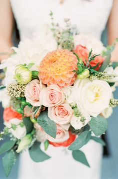 Dahlia & Rose Bouquet | On SMP: http://www.StyleMePretty.com/2014/03/04/coral-wedding-at-mountain-magnolia-inn/  D'Arcy Benincosa Photography