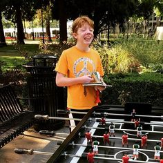 Foosball in the park with the light rail in the background.