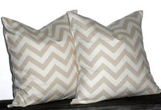 These gorgeous Khaki and Natural Chevron pillow covers will brighten and modernize any room. Due to their neutral color they go with any decor!This is for a pair of TWO pillow covers made to fit on 22 x 22 inch pillow forms.Our pillow covers feature: Boys Curtains, Gingham Curtains, Red Curtains, Neutral Pillows, Chevron Home Decor, Home Decor Fabric, Arrow Pillow, Pillow Set