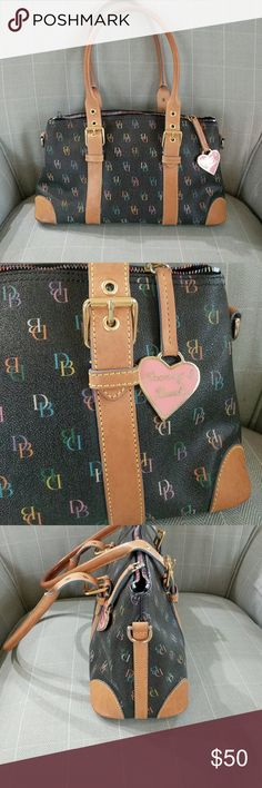 Dooney Bourke handbag Black with multicolor signature DB on the body.  Leather adjustable straps. A great all year round handbag. Goes with everything the bag is 13 1/2 wide and 8 inches tall Dooney Bourke Bags Shoulder Bags