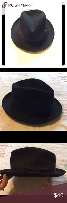 Vintage Men's Fedora This listing is for one wonderful fedora. This vintage black fedora by Dobbs, Fifth Avenue, is in great condition. The size tag is still in it! 7 1/8 is the size and the black is as lush as can be. There are a few very light stains on the inside of the hat. However, the inside rim looks unused. Dobbs Accessories Hats