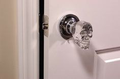 This is probably my favorite idea in non-cheesy horror decor -- skull door knobs.