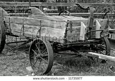 Old wooden farm implement (manure spreader). - stock photo