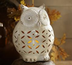 I love owls! Especially ones that double as a candle holder! Punched Ceramic Owl Luminary from Pottery Barn.