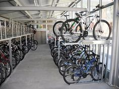 Custom bicycle shelter projects completed by Duo-Gard using sustainable designs and translucent materials. Bike Storage Office, Bicycle Storage, Bicycle Rack, Bike Shelter, Bike Room, Cycle Shop, Bike Parking, Parking Design, Garage