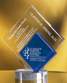 The Glass Peak Duet Award is a fusion of clear and blue optical glass, deep etched with your custom engraving and logo. The award is elevated on a handsome brushed silver base.     http://www.edco.com/cat/metal-and-glass-awards