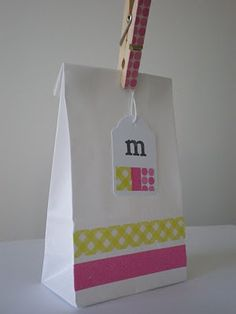 Decorate a simple paper bag with washi tape & clothespin; i love how adorable this looks and simple too