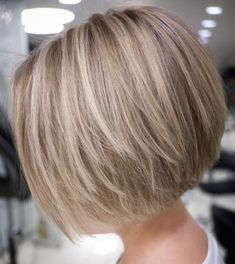 Straight Textured Creamy Blonde Bob Your stick-straight hair will look healthy and neat when you cut it into a short layered bob. A simple blowout with a side part provides a sophisticated professional look. Soften it up by wearing a pretty headb Layered Bob Short, Short Hair With Layers, Short Hair Cuts, Short Hair Styles, Layered Bobs, Angled Bob With Layers, Medium Layered, Angled Bob Hairstyles, Bob Hairstyles For Fine Hair