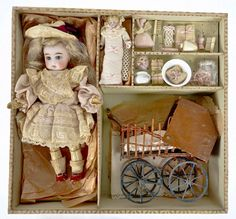 Extremely cool Jumeau doll set (with tiny doll, buggy and accessories).