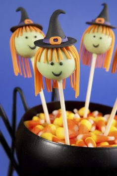 Round mini cake pops dipped in candy melts and decorated with fondant to look like witches. (Olga Lyubkina/Photos.com)