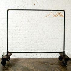 Rolling rack idea, also love the white brick
