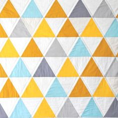 Love the triangular quilting on the outside of the pieced triangles