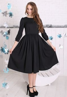 Modest black midi dress with sleeves coming soon to Mode-sty