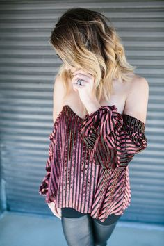 Blogger Lindsey Lutz from Life Lutzurious wearing a burgundy velvet off the shoulder top as seen on Chrissy Teigan