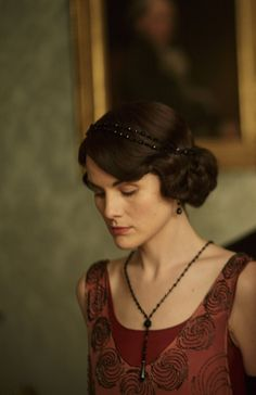 Lady Mary Crawley wearing jet black crystal headpiece, jet crystal earrings and daring back-draped necklace with black crystal pendant.