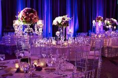 Reception space at the Sofitel ballroom with tall garnier vases and candelabra centerpieces