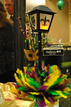 Mardi Gras centerpiece. @Jess Pearl Pearl Liu Scott these would be awesome wedding centerpieces for you!