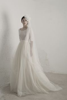 Matilda dress by Cortana. Wedding dresses for women that seek excellence. Designed and crafted in our atelier in Barcelona with the spirit of couture. 3/4 sleeve tulle ball gown.