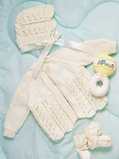 baby layette knitting pattern creates a matching set of delicate baby jacket and baby bonnet. The baby bonnet and jacket are tied with sweet satin ribbon. Pair with knitted baby booties. - Crochet and Knit Knitting For Kids, Baby Knitting Patterns, Baby Patterns, Free Knitting, Crochet Patterns, Knitting Looms, Layette Pattern, Bonnet Pattern, Bernat Baby Yarn