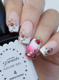 Another idea how to enrich your french manicure for the upcoming holidays. Tih manicure is richly done, French manicure is nice combined with an ombre style on ring finger, and gold snowflakes and red rhinestones are really in the spirit of the holidays …