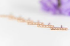 Our Diamond Bar Earrings are classic and dainty - they come in rose gold, but other gold colors are available upon order!