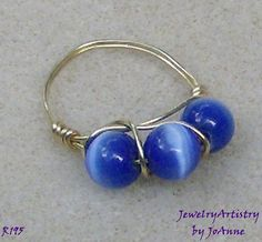 Size 5 & absolutely beautiful. Royal blue cats eye beads wrapped with 14 kt gold filled wire. This is one fantastic wire wrapped ring. One that