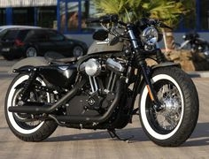 Customized Harley-Davidson with solo leathersaddle, TB classic aircleaner and whitewalls. Built by Thunderbike Customs Germany
