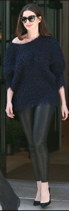 Anne Hathaway in Purse – Givenchy  Pants – J Brand  Shoes – Christian Louboutin  Jewelry – John Hardy