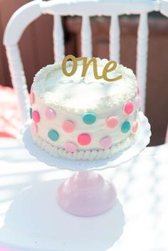Cute cake at a polka dots and pinwheels birthday party! See more party ideas at CatchMyParty.com!