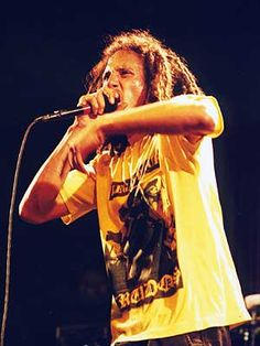 Zack de la Rocha, Rage Against The Machine. Read my writing on the wall  No-ones here to catch me when I fall  Caught between my culture and the system....genocide!