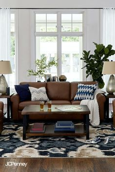 Creating a stylish living area is easy with these tips. Start with your sofa—the centerpiece of the room. Build around it by adding a coffee table and side tables. Mix in warm touches like lamps…More Brown Leather Couch Living Room, Brown And Blue Living Room, Cream Living Rooms, Rugs In Living Room, Living Room Decor, Living Area, Brown Couch Decor, Dark Brown Couch, Living Room Color Schemes