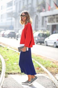 How To Dress Like An Italian Girl — 50+ Lessons Worth Knowing #refinery29  http://www.refinery29.com/2014/09/74945/milan-fashion-week-2014-street-style#slide77  Primary colors in dramatic silhouettes makes for a truly stunning one-two punch of hues.