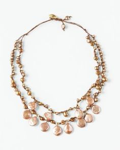 Unrivaled in elegance, this stunning layering necklace makes a glamorous statement. Waxed linen cord wends its way through a mix of freshwater cultured pearls and gold-plated copper nuggets that glimmer from every angle.