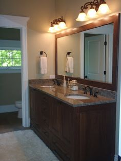 Double sink vanity and separate toilet. Definitely a fan of the counter top and the lights above the mirror. However, I might want a little more storage--possibly some more drawers.