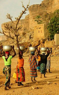 Women carrying water on their heads to a Dogon village, Mali, by Raphael Bick African Beauty, African Women, African Art, Out Of Africa, West Africa, We Are The World, People Around The World, Michel Leiris, Thinking Day