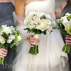 round bouquets of peonies, lisianthus, freesias, and roses